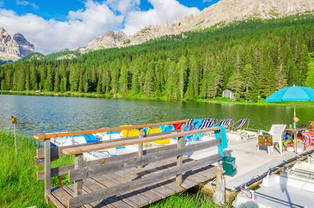 lake misurina: Colored pedalos on the Lake Misurina - lago di Santa Caterina and Auronzo di Cadore, Province of Belluno of Veneto in Sexten Dolomites, South Tyrol in Italy Editorial