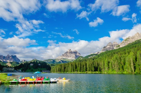 lake misurina: Colored pedalos on the Lake Misurina lago di Santa Caterina and Auronzo di Cadore in Province of Belluno, Veneto in Sexten Dolomites, South Tyrol, Italy Editorial
