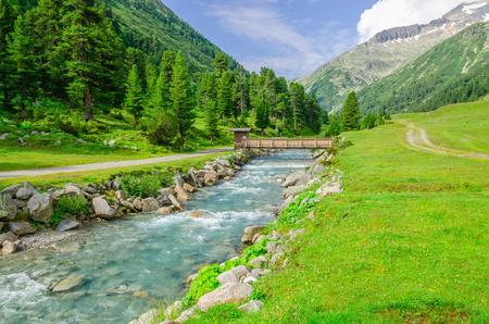 austrian: Mountain stream and the high peaks of the Austrian Alps