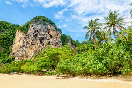 railay: Amazing Railay Beach with mogotes, long tail boat andred kayaks, Krabi, Thailand