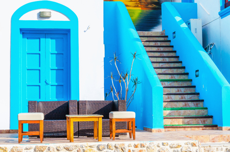 ionian island: Sofa in front of typical Greek house painted with blue and white, Greece