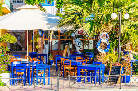 kalymnos greece may 01 2015 blue wooden tables in greek restaurant in - Blue Restaurant 2015