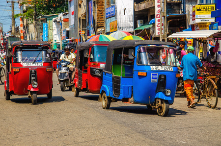 SRI LANKA, COLOMBO - JANUARY 9, 2015: Tuk tuk Sri Lankan traditional taxi in one of the street of Colombo Stock Photo - 40485732