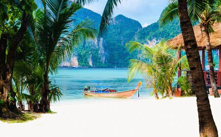 Amazing view of the coast of the island of Phi Phi Don with long tail boat, Thailand