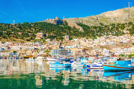 greek island: Colorful boats in small port on Greek Island, Greece Editorial