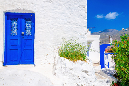 greek islands: Iconic blue wooden door against clear white wall. Typical view for Greek islands, Greece