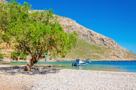 skiathos: Greek pebble beach in a beautiful quiet bay, Greek Islands, Aegean Sea