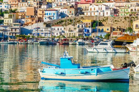 greece shoreline: Small wooden colorful fishermens boat in cosy Greek Port, Greece
