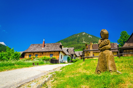 liptov: Beautiful Vlkolinec traditional village in Slovakia with carved sculpture, Eastern Europe