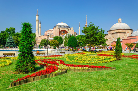 Beautiful Hagia Sophia with garden full of colorful flowers, Christian patriarchal basilica, imperial mosque and now a museum, Istanbul, Turkey