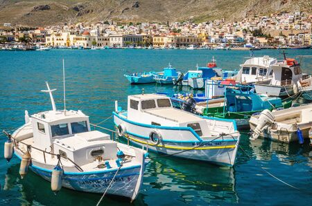 KALYMNOS, GREECE - MAY 01, 2015: Wharf and cosy traditional Greek boats in port of Pothia, Kalymnos, Greece