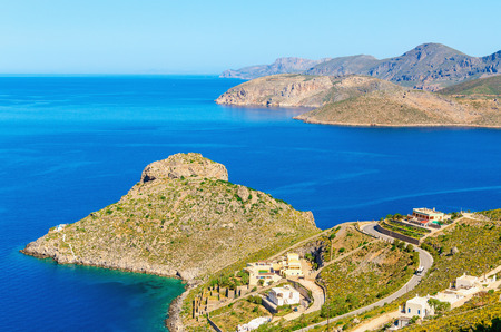 romance sky: Peacful view on cozy green peninsula in day with clear blue sky of Kalymnos Greek island, Greece