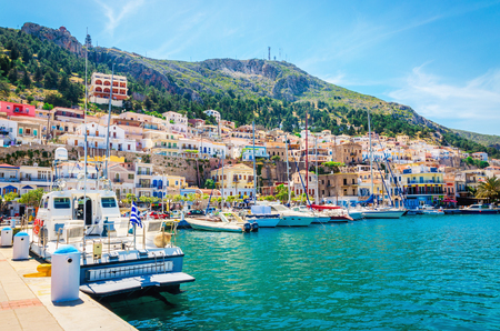 KALYMNOS, GREECE - MAY 01, 2015: Colorful boats moored in Greek port, Greece