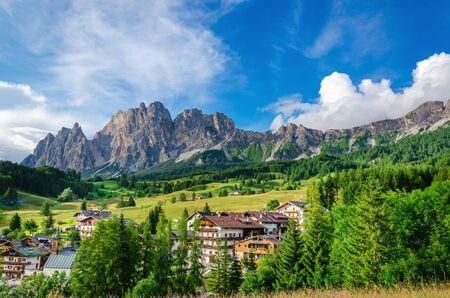 green ridge: Amazing view on Cristalo ridge and green fresh meadows in Dolomites near Cortina dAmpezzo, Italy Stock Photo