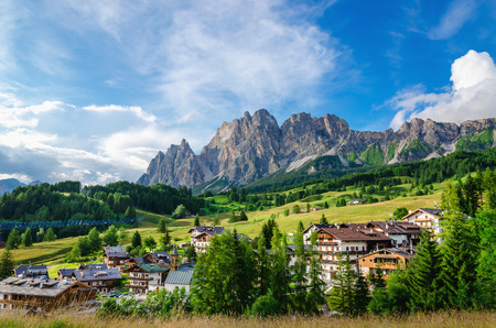 Amazing view on Cristallo Mountains with alpine village on sunny summer day, The Dolomites Mountains, Italy Zdjęcie Seryjne