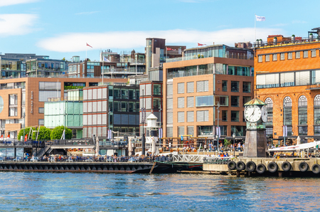 OSLO, NORWAY - 21 JUNE, 2015 - Clock on Aker Brygge Dock, modern and very popular part of Oslo, Oslo Fjord, Norway, Scandinavia Editorial