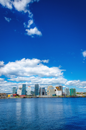 The modern business district in Oslo on a background of blue sky and the blue water of the sea, Norway, Scandinavia