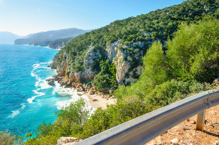 Scenic road on coast of Sardinia island with view of Porto sa Ruxi beach, Sardiniia, Italy