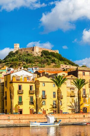 Amazing colorful houses and the old fort above them, Bosa, Sardinia, Italy, Europe