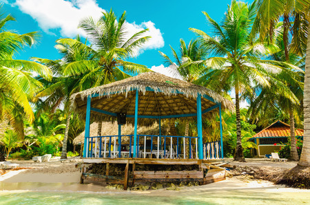 Beautiful exotic beach with wooden gazebo, Dominican Republic, Caribbean island Stock Photo