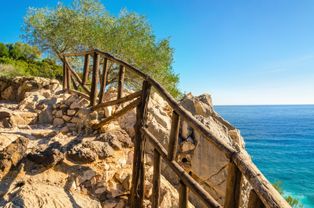 Wooden walk path to Sardinia beach , Golfo di Orosei, Italy Stock Photo