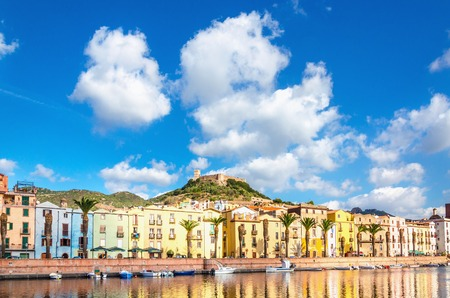 Colorful buildings beautiful Bosa on a background of blue sky, Sardinia Stock Photo