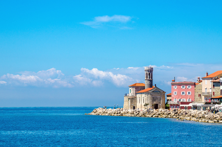 Rocky promontory, lighthouse and tower church of Clement, Piran, Slovenia Europe