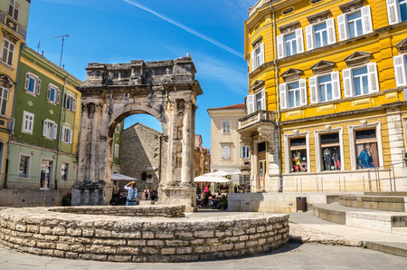 Ancient Roman triumphal arch or Golden Gate and square in Pula, Croatia, Europe Stock Photo