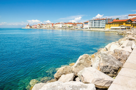 View of rocky promontory small lighthouse tower church , Piran, Solvenia Stock Photo - 87301401