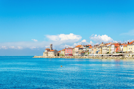 Rocky promontory with a small lighthouse, Piran, Slovakia, Europe Stock Photo