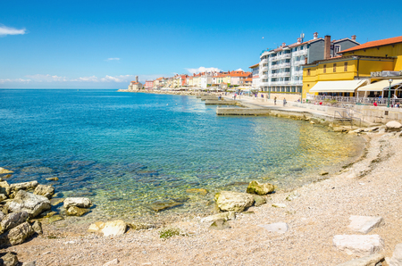 Beach along the waterfront of the historic little town Piran, Slovenia, Europe