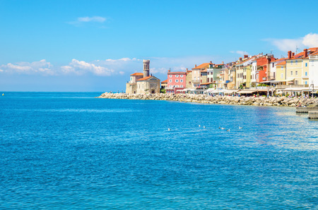 Chapel and colorful houses on the pier, Piran, Slovakia, Europe