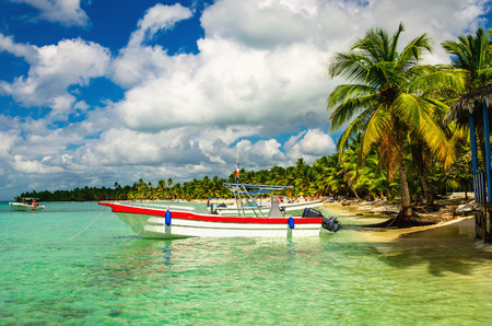 White and red boat on shore of Caribbean Islands, Dominican Republic