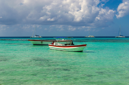 Colorful wooden boats on azur beautiful Caribbean, Dominican Republic