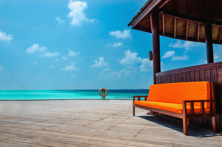 Beautiful view of the turquoise water of the Indian Ocean from the pier of a hut, Maldives