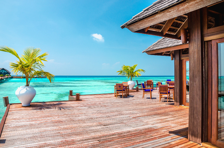 A wooden restaurant on the water against the backdrop of the azure waters, Indian Ocean, Maldives