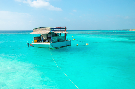 A typical fishing boat for the Maldives against the azure water of the Ocean