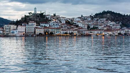 vacance: Greece, the port of Poros island at dusk