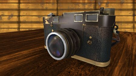 antiquities: Vintage photo camera on a brown wooden table