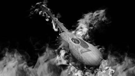 classical guitar: Acoustic classical guitar in smoke on black background