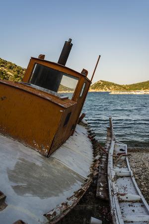 trawler: Abandoned fishing trawler on beach at Alonissos, Greece Stock Photo