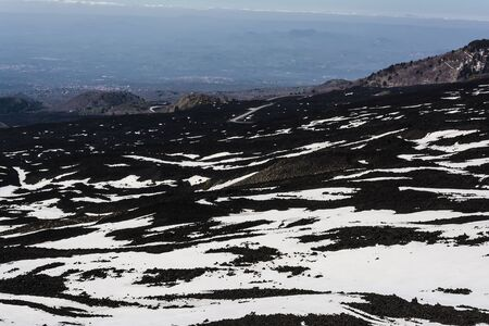 eruptive: Etna mountain landscape, volcanic rock and snow, Sicily, Italy Stock Photo