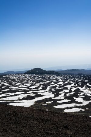 dejection: Etna mountain landscape, volcanic rock and snow, Sicily, Italy Stock Photo
