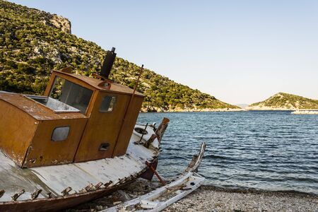 trawler: Abandoned fishing trawler on beach at Alonissos Greece