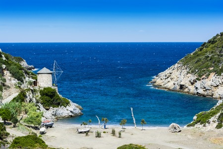 The beach of Lakes is a small rocky cove with some sand, found at north of the old town of Alonissos, known as Old Alonissos. 免版税图像 - 41978427