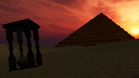 utopia: Sand timer in desert with Pyramid background at sunset - time passing Stock Photo