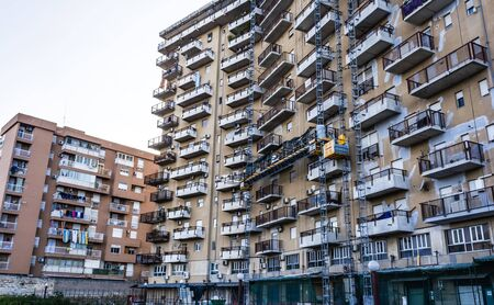 poorness: Building exterior with windows and balconies in Palermo, Sicily, Italy