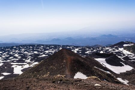 eruptive: Etna mountain landscape, volcanic rock and snow, Sicily, Italy Stock Photo