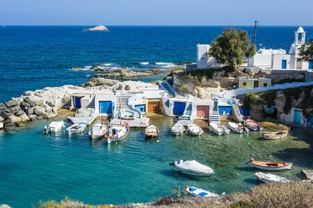 fishermen's: Mandrakia traditional Greek village with sirmate  - traditional fishermens houses at Milos island, Greece. Stock Photo