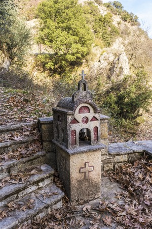 cross roads: Small christian church in the forest, Greece